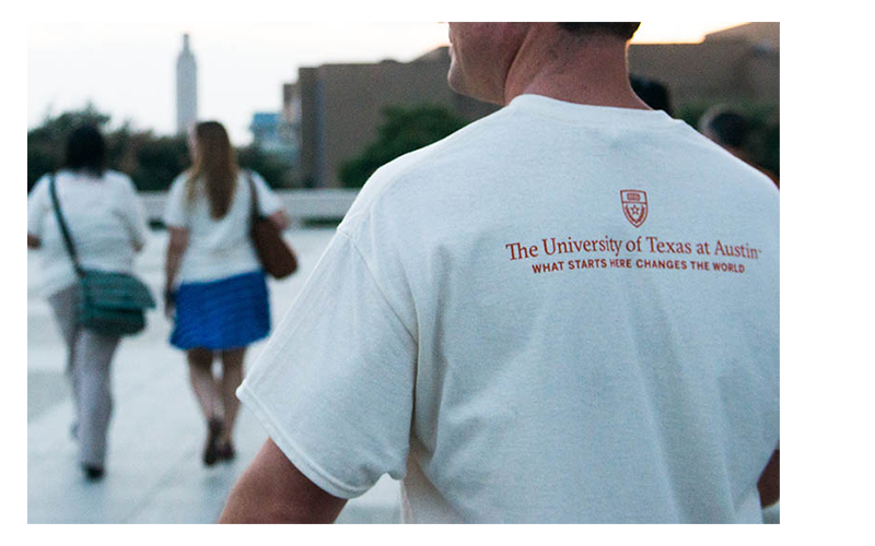 """Gone to Texas 2015: An LBJ student wears a UT T-shirt reading """"What starts here changes the world."""""""